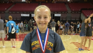 Seventh grader, Mary Jo Dalsin, from New Prague, Minnesota, at the National History Day Competition in Washington, D.C., with her 3rd place medal in the junior individual documentary division for her video on the Japanese American Internment during World War II.  Photo credit:  Emily Dalsin.